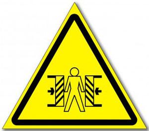 Табличка «внимание опасность зажима»